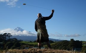 Rangi Kipa swings a purehua at Parihaka  to gather the spirits ahead of the Crown's arrival for the apology.