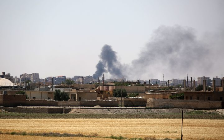 Smoke rises from buildings in the al-Meshleb neighbourhood of Raqqa as the Syrian Democratic Forces advance on 7 June.