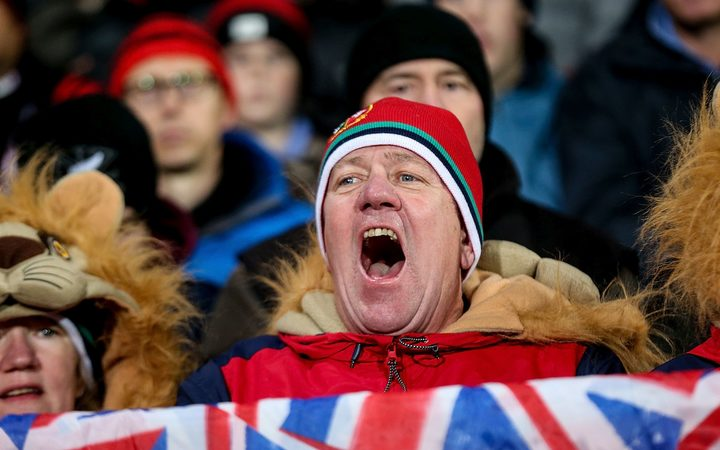 A Lions fan rejoices at the match against the Crusaders.