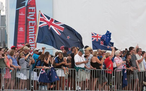 Team New Zealand supporters cheer for the team as they leave the dock on day one of the challenger playoff finals against Artemis.