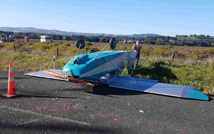 The plane landed upside down - but the pilot walked away from the crash.