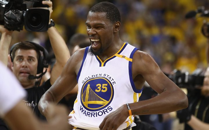 Golden State Warrior Kevin Durant celebrates winning his first NBA championship title.