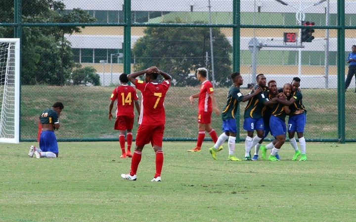 Raymond Gunemba (7) puts his hands on his head as Solomon Islands skipper  Henry Fa'arodo equalises from the penalty spot in the first half.