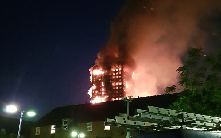 The fire engulfs the Grenfell Tower apartment building.