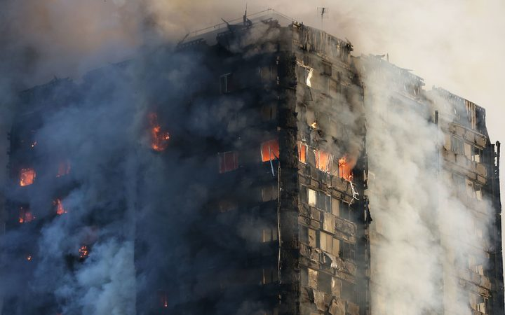 Smoke billows from Grenfell Tower as firefighters attempt to control a huge blaze on June 14, 2017 in west London. The massive fire ripped through the 27-storey apartment block in west London in the early hours of Wednesday