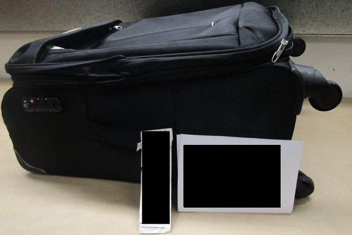 Cocaine packs were discovered in a false bottom suitcase.