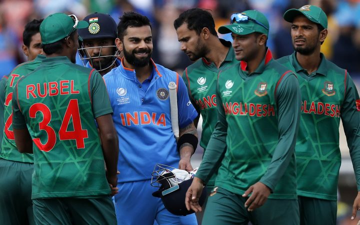 India's batsman Virat Kohli (C) is congratulated by Bangladesh players after winning the ICC Champions Trophy semi-final
