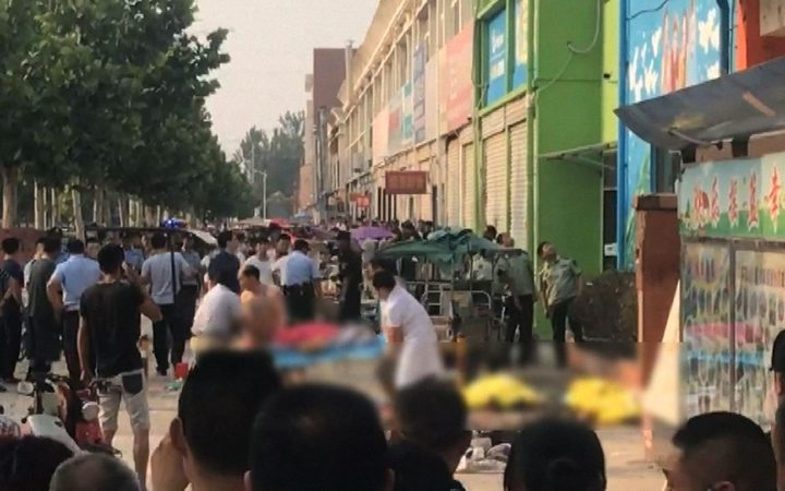 This screengrab taken from a broadcast by China's State broadcaster CCTV  shows the aftermath of an explosion outside a kindergarten in the eastern Chinese city of Xuzhou.