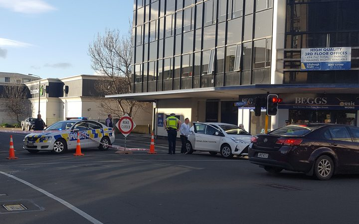 Police at the cordon after the suspicious package was found in Dunedin city centre.