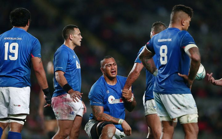 Manu Samoa players, including captain Kahn Fotuali'i (2L), react after their 78-0 thrashing by the All Blacks.