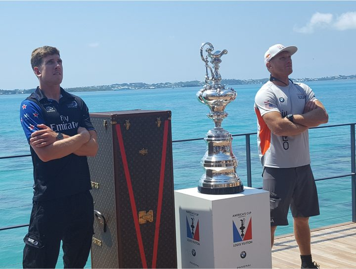 Team NZ helmsman Peter Burling, left, and Oracle Team USA's skipper Jimmy Spithill with the America's Cup in Bermuda.