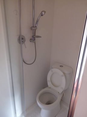 The shower fitted over a toilet in the West Auckland unit.