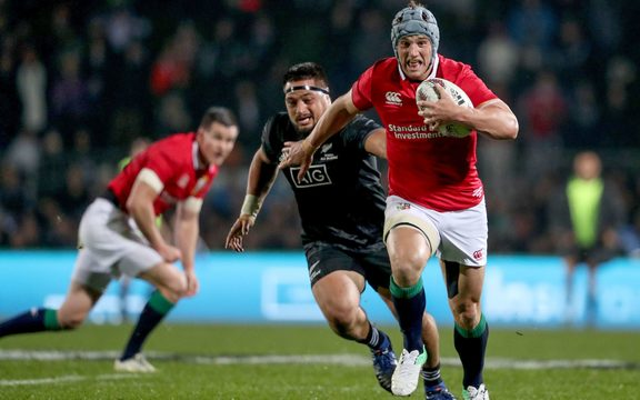 Jonathan Davies makes a break for the Lions.