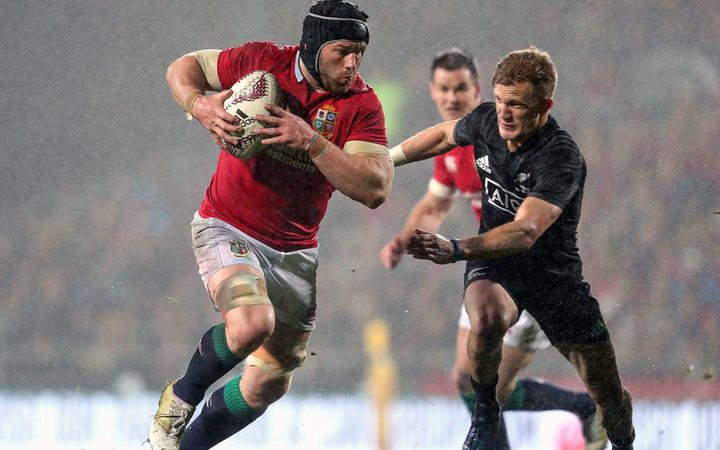 Lions' Sean O'Brien is chased by Damian McKenzie.