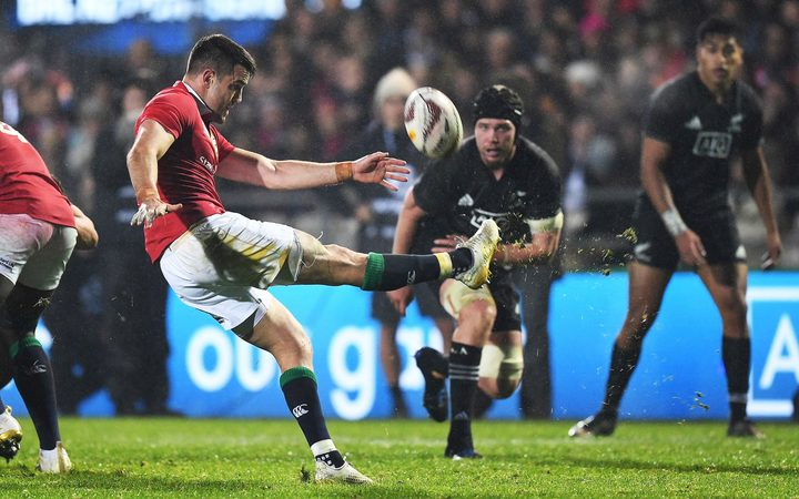 Conor Murray takes a kick.