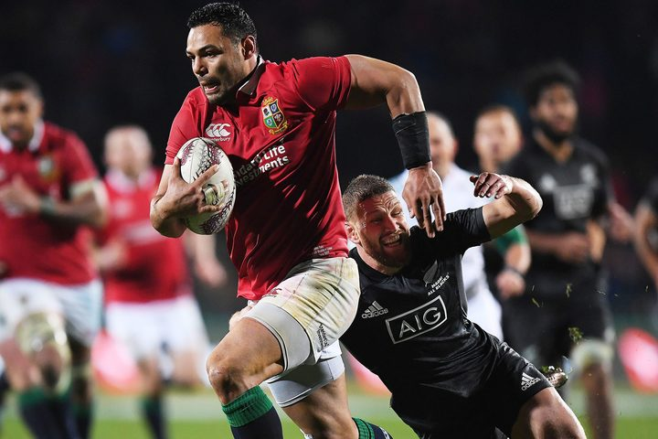 Ben Te'o makes a break for the Lions.