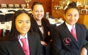 Misty Harrison (centre) with her two nieces Ngawai Kowhai Harrison (left) and Te Waiata Harrison Mason (right)