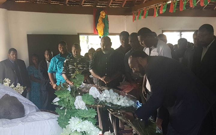 Vanuatu's prime minister Charlot Salwai pays his respects to the late president Baldwin Lonsdale during his lying in state June 2017