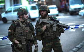 Soldiers stand at a cordoned off area on a street outside Gare Centrale in Brussels.