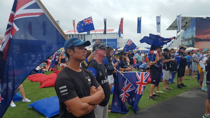 Team New Zealand fans cluster in front of the dockout show stage,