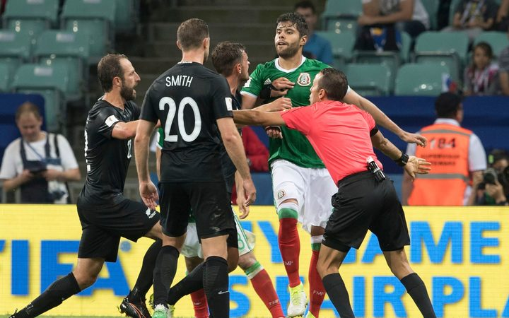 Confrontation between players during the match Mexico vs New Zealand