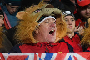Lions fans celebrate their win during the rugby union match between the Crusaders and the British and Irish Lions at AMI Stadium in Christchurch on June 10, 2017.