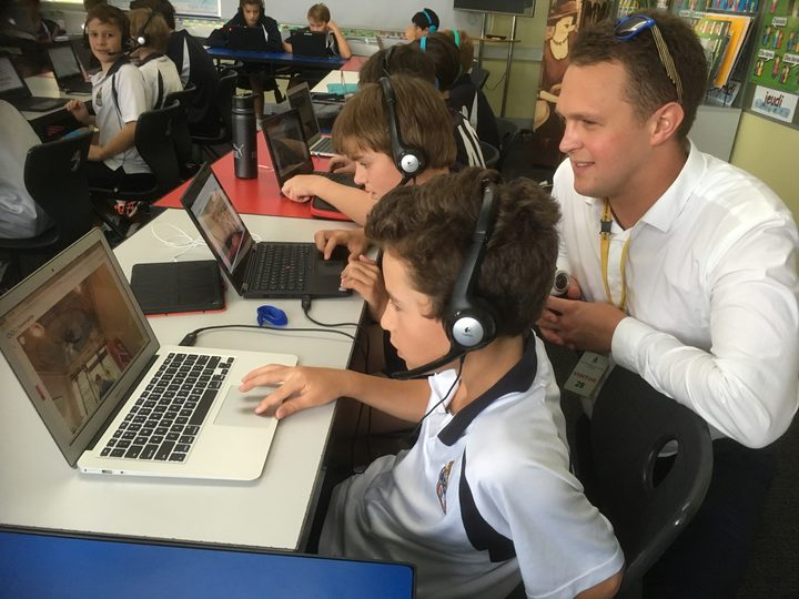 Scott Cardwell with students using the new Immerseme language programme.
