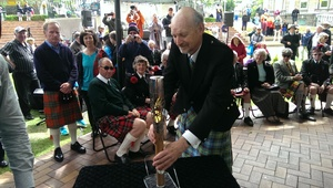 City Councillor Neville Peat places the baton on a table in the Octagon.