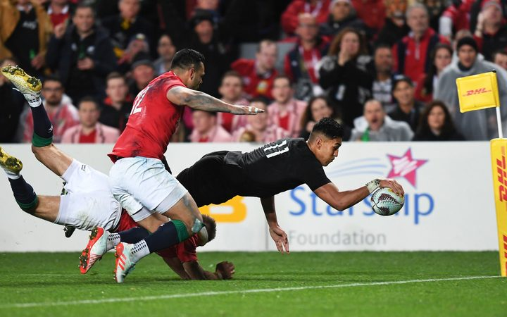 Rieko Ioane goes in for his try.