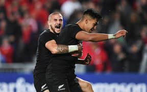 Rieko Ioane after scoring his second try, celebrating with TJ Perenara.