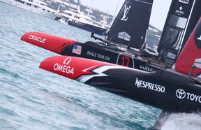 Oracle Team USA and Emirates Team New Zealand during race six.