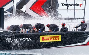 Team New Zealand brace through a wave in the third day of America's Cup racing.