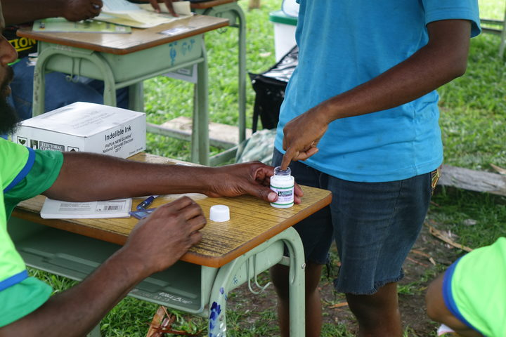 PNG voters must dip a finger into indelible ink before voting, an effort to ensure they don't vote twice.