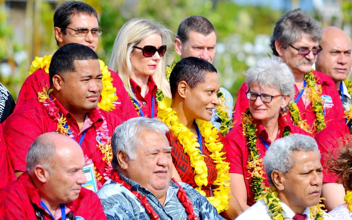 The Samoan prime minister Tuilaepa Sailele Malielegaoi is photographed with conference delegates in red.