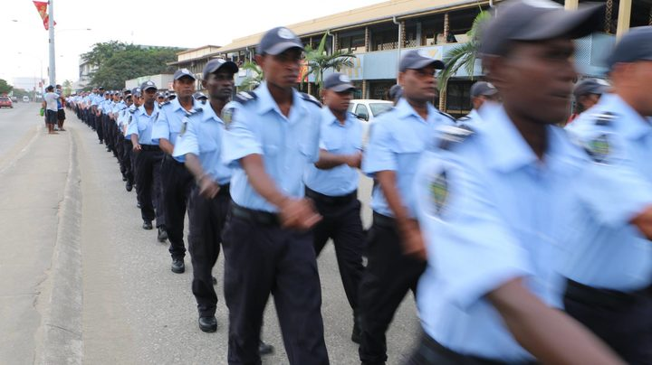 Police march during the Solomon Islands parade.