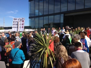 Protesters outside the Southern Response office in Christchurch.