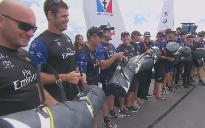 Team NZ's sailors were presented with pricey bags from America's Cup sponsor Louis Vuitton - some of which were quickly thrown into the crowd.