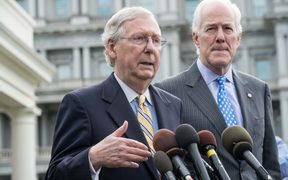 US Senate majority leader Mitch McConnell and majority whip John Cornyn speak to the press outside the West Wing of the White House after Republican senators met with US President Donald Trump to discuss the healthcare bill in Washington, DC.