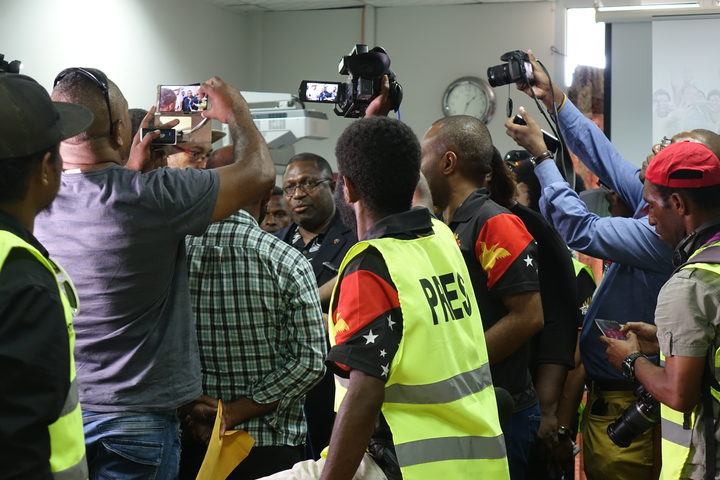 PNG Electoral Commissioner Patilias Gamato under pressure at a media conference