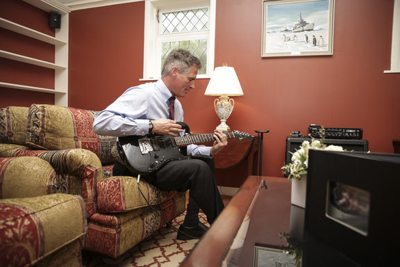 Scott Brown, US Ambassador to New Zealand at his Lower Hutt home plays guitar for media.