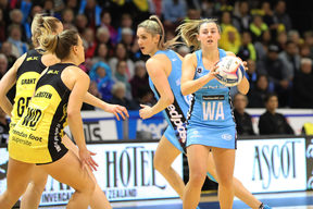 Gina Crampton of the Steel, right, looks to pass the ball during the ANZ Premiership Final against the Central Pulse.