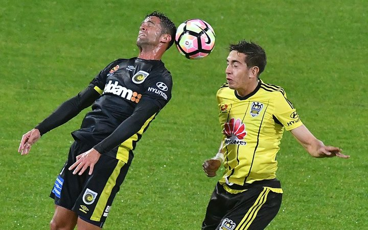 New Phoenix signing Scott Galloway (left), playing for the Central Coast Mariners,  contests the ball with the Phoenix's Alex Rodriguez.