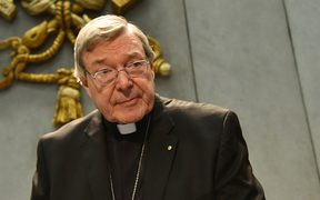 Australian Cardinal George Pell looks on as he makes a statement at the Holy See Press Office in the Vatican City.