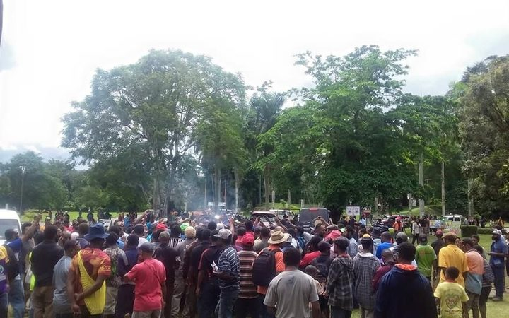 Hundreds gather to watch PNG ballot papers burnt at Unitech polling booth.