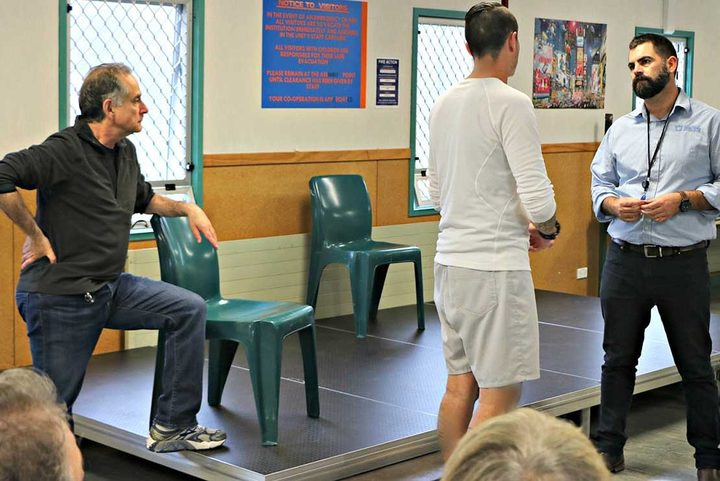 David (left) during the workshop at Paremoremo Prison, where he used Theatre for Living techniques to explore issues (photo/Department of Corrections)