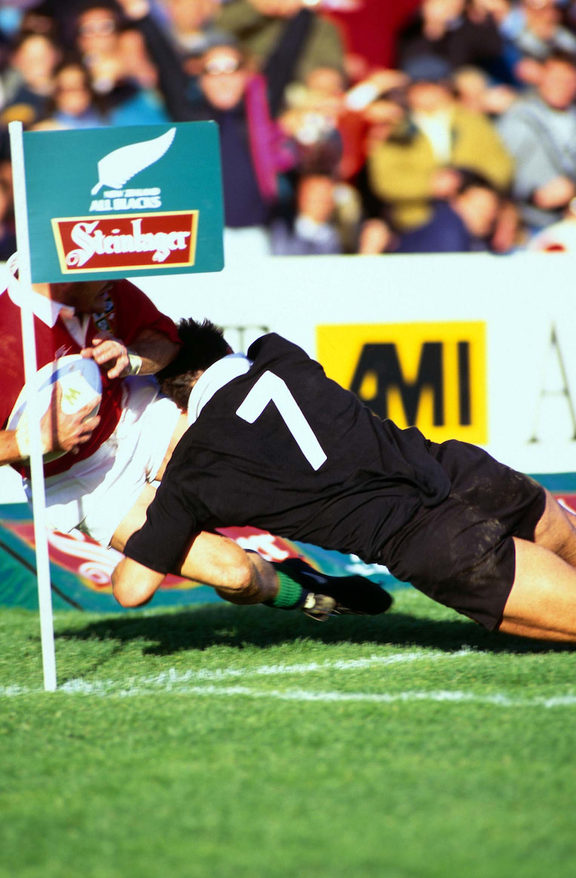 Michael Jones makes a try-saving tackle during the 1993 clash between the Lions and the All Blacks in Wellington.
