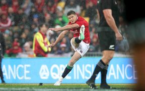 Owen Farrell kicks a penalty.