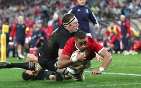 Taulupe Faletau scores the first try for the Lions.
