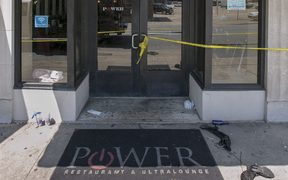 Police tape surrounds the Ultra Power Lounge as Little Rock Police Department detectives and crime scene personnel collect evidence on July 1, 2017 in Little Rock, Arkansas following a shooting which injured 28 people.