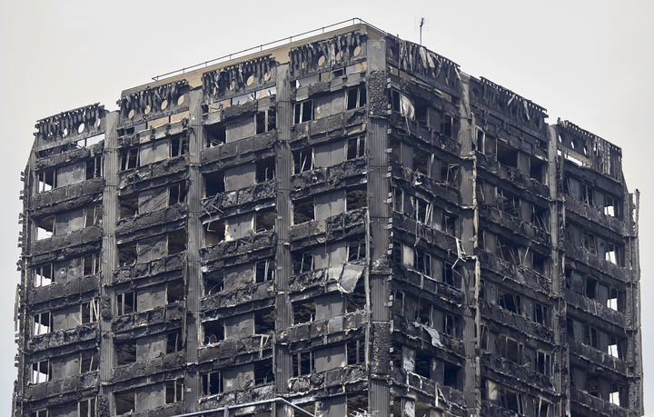 The charred remains of cladding are pictured on the outer walls of the burnt out shell of the Grenfell Tower block in north Kensington, west London, on June 22, 2017.